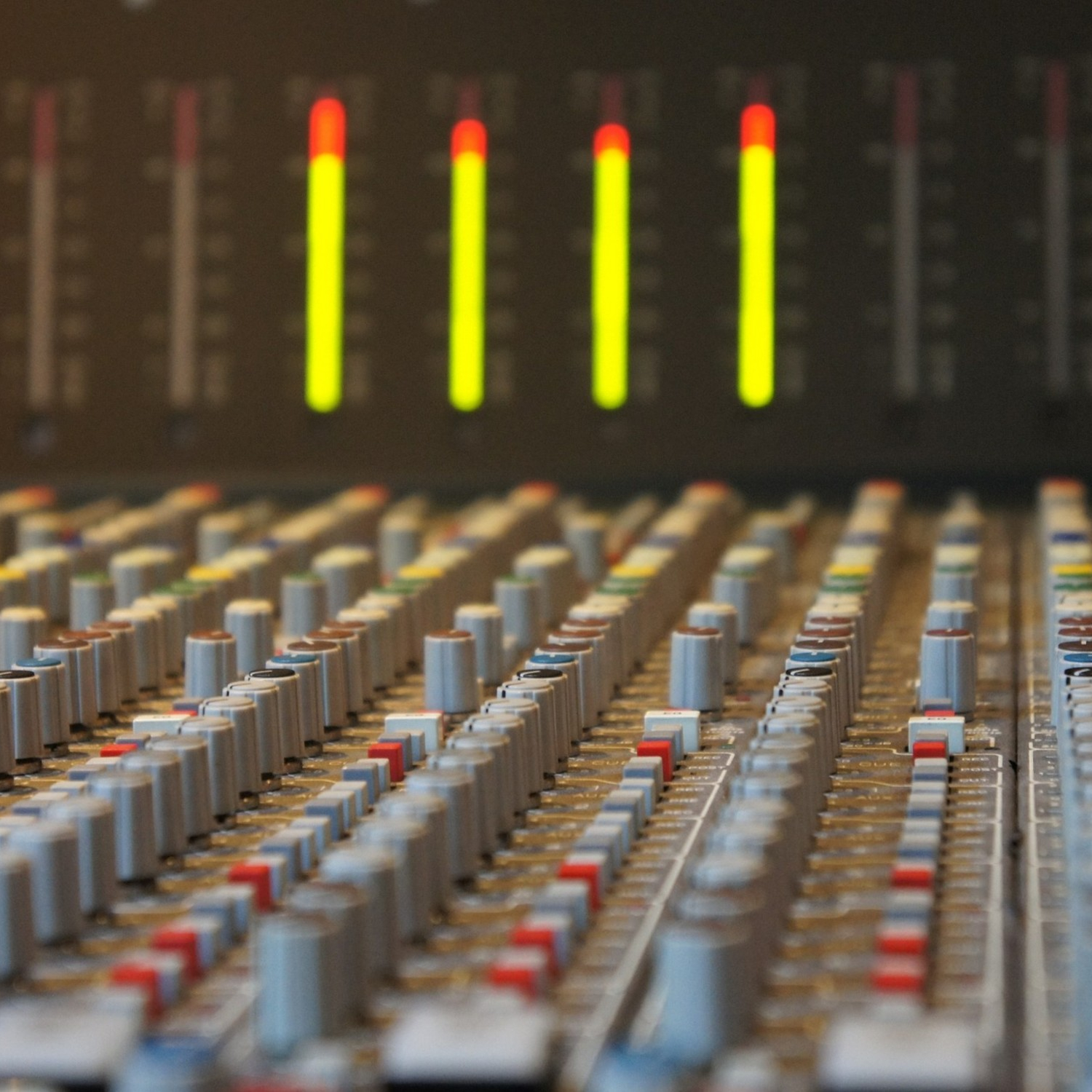 sound meters on a mixing console